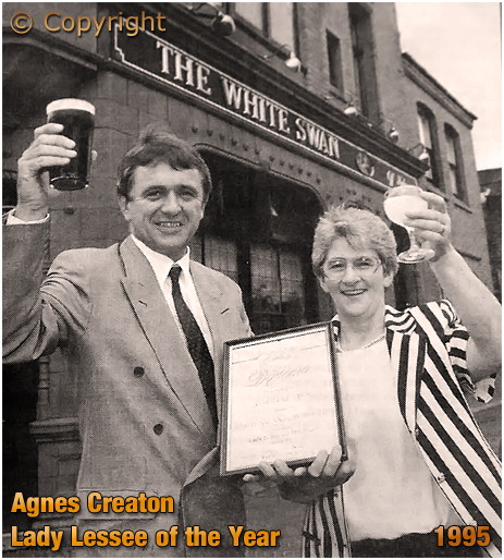 """Birmingham : Agnes Creaton receiving the """"Lady Lessee of the Year."""" award from Ansell's regional director Mark Hodgkinson outside the White Swan in Deritend [1995]"""