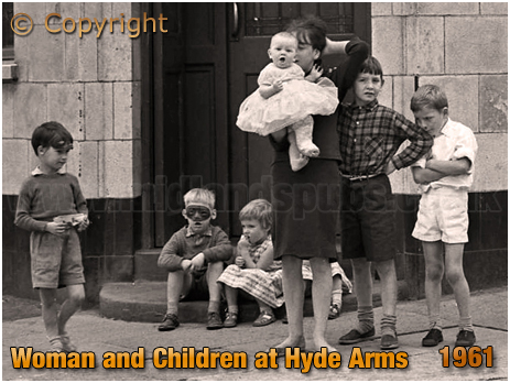 Woman and Children outside the Hyde Arms on the corner of Clark Street and Hyde Street at Ladywood in Birmingham [1961]