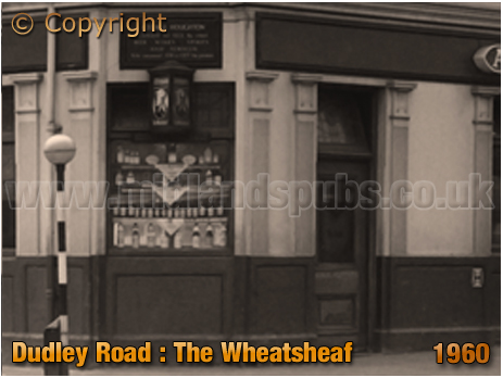Off Sales Window Display at the Wheatsheaf Inn on the corner of Dudley Road and Icknield Port Road at Winson Green in Birmingham [1960]