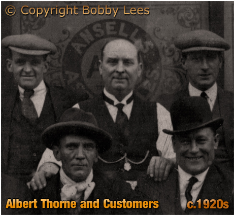 Birmingham : Albert Thorne with some of his customers outside the Pelican Inn on the corner of Great King Street and Unett Street in Hockley [c.1920s]