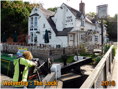 Woman winding the lock gates at Wolverley [September 2016]