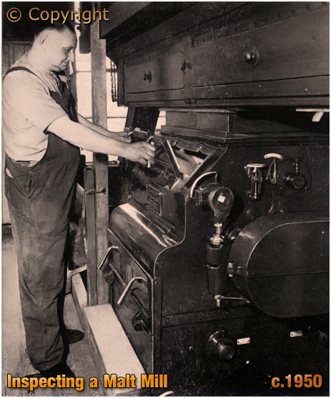 Inspecting a Malt Mill at Ansell's Brewery [c.1950]