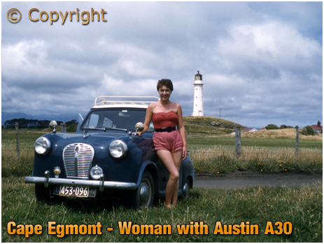 New Zealand : Woman with Austin A30 Car at Cape Egmont Lighthouse [c.1958]