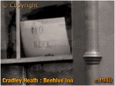 Cradley Heath : Licensee Board with name of Rachel Garrett at the Beehive Inn on the corner of Grainger's Lane and Southgate [c.1940]