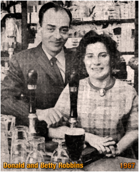 Donald and Betty Robbins behind the bar of the Duke Inn at Maney in Sutton Coldfield [1967]